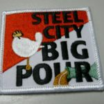 Steel City Big Pour Iron on Patch, half red/half white with bird logo and pouring bottle.